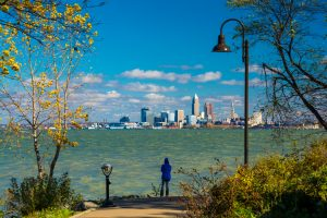Woman Looking At Cleveland Skyline From Park